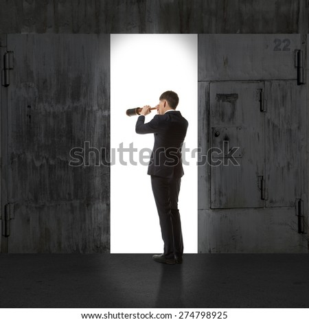 Infinity. Rear view of a businessman standing in front of the exit light - stock photo
