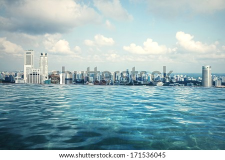 Infinity swimming pool of the Marina Bay Sands in Singapore. - stock photo