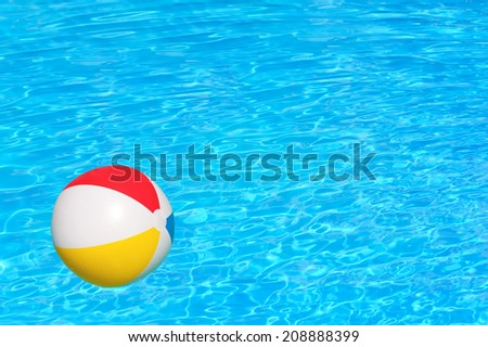 Inflatable ball floating in swimming pool