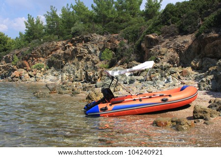 Inflatable boat on the beach - stock photo