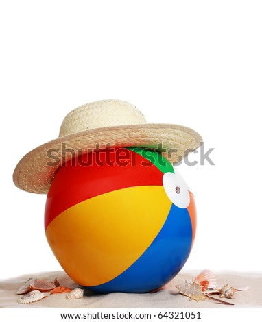 inflatable colorful beach ball and hat on sand and seashell - stock photo