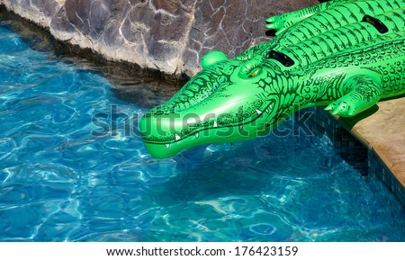 Inflatable Crocodile At The Edge Of A Pool