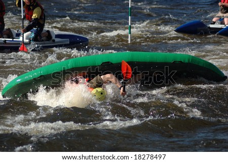 Inflatable kayak in a threshold on the rough river - stock photo