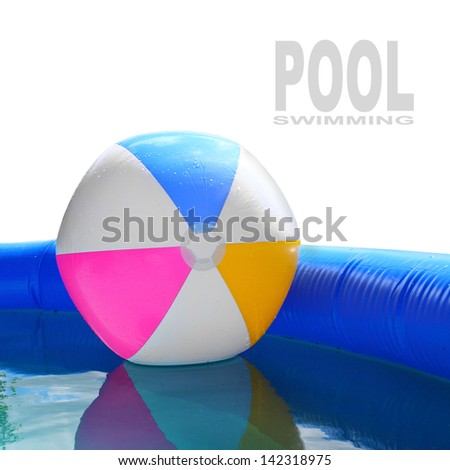 Inflatable pool with floating plastic ball. - stock photo