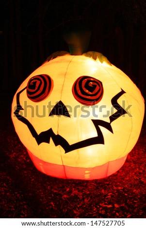 Inflatable pumpkin in a dark - stock photo