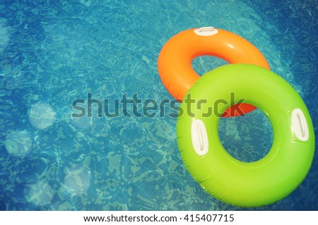 Inflatable ring in water, concept of the summer timer