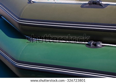 Inflatable rubber boat for fishing and recreation - stock photo