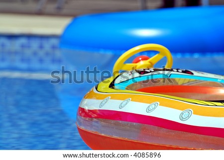 Inflatable toys in the pool - stock photo