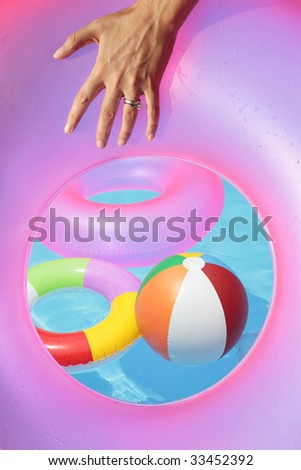 Inflatable toys seen through a rubber ring - stock photo