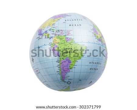 Inflated plastic earth toy showing South America - stock photo