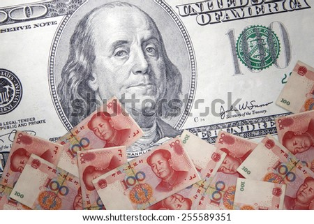 Inflation Chinese yuan against the backdrop of the US dollar - stock photo