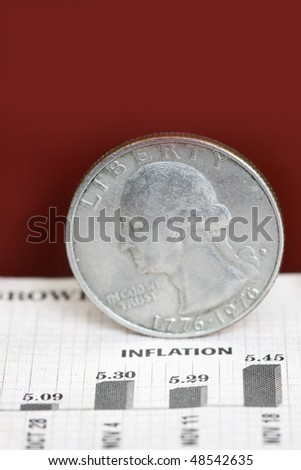 Inflation concept with quarter dollar in a dark background.