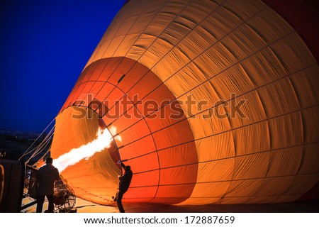 Inflation of hot air balloon - stock photo