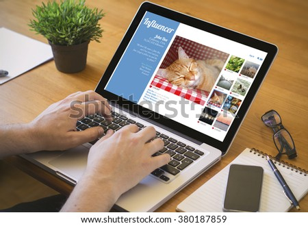 influencer marketing concept. Close-up top view of a coolhunter working on laptop. all screen graphics are made up.