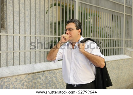 Influenza: Man coughing outdoors - stock photo