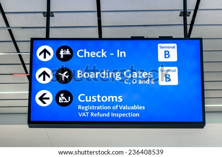 Info sign at international airport - Directions for check in and boarding gates - Registrations and custom at terminal connections - stock photo