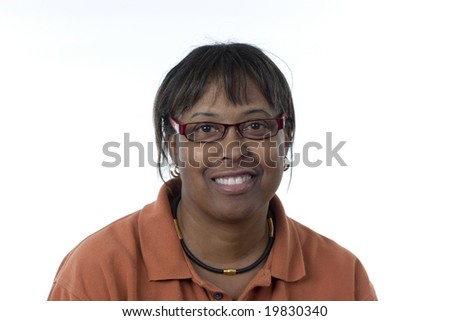 informal portrait of a black middle-aged woman smiling wearing glasses looking directly at the camera - stock photo