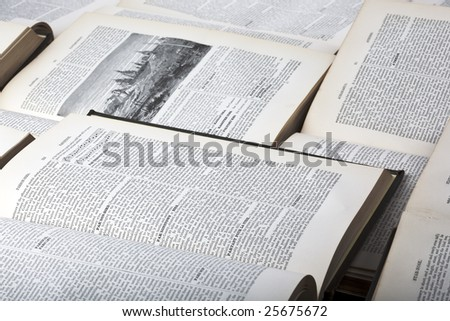 Information and knowledge concept background formed of multiple open old encyclopaedia - stock photo