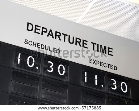 information board at airport with flight delay - stock photo