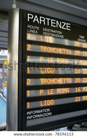 "Information board showing ""Vaporetto"" water bus departures in Venice, Italy."