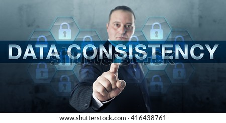 Information manager is pushing DATA CONSISTENCY on translucent interactive visual display. Business metaphor and information technology concept for protection against disaster and data loss. - stock photo