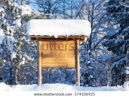 Information sign in winter landscape - stock photo