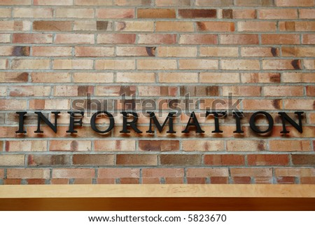 Information Sign on Brick Wall - stock photo