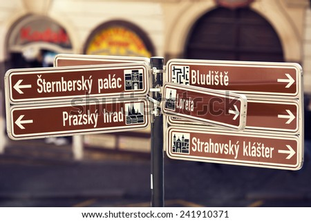 Information street sign in Prague, Czech republic on the blurred street background - stock photo