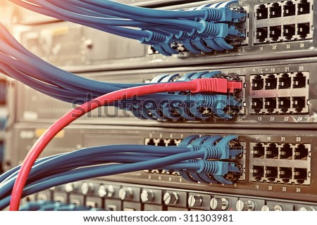 Information Technology Computer Network, Telecommunication Ethernet Cables Connected to Internet Switch. - stock photo