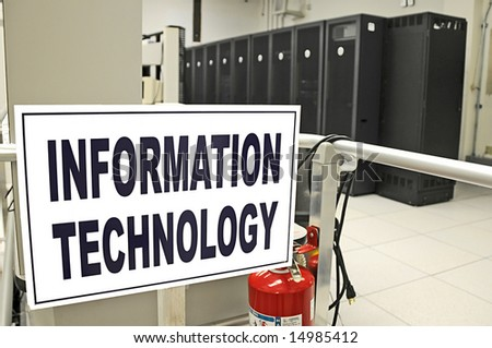 Information Technology data center room with data racks in the background - stock photo