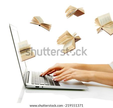 Information transfer. Books flying in laptop - stock photo