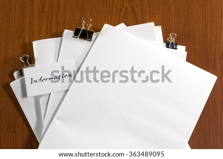 Information; White Blank Documents with Small Message Card. - stock photo