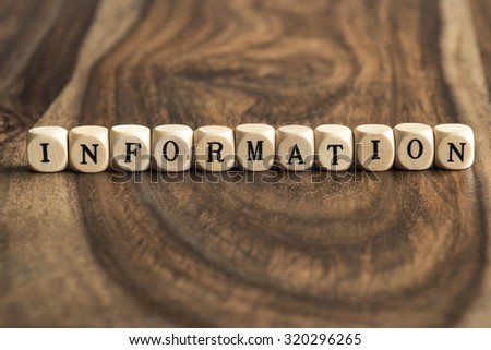 INFORMATION word background on wood blocks - stock photo