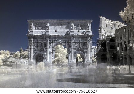 Infrared, false colour, long exposure, detail of Arch of Constantine with partial view of Colosseum (coliseum), Rome, Italy. Trails left by passing tourists look a bit like ghosts. - stock photo