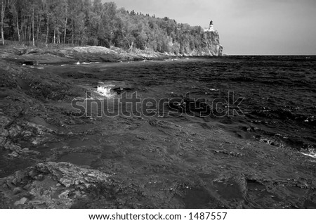 Infrared. Green water under Split Rock Light House on Lake Superior North Shore. More with keyword Series14. - stock photo