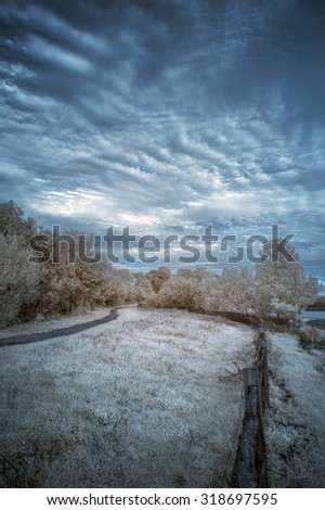 Infrared landscape of lake in English countryside in Summer with surreal colors - stock photo
