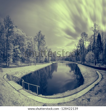 Infrared landscape to the lake and park - stock photo