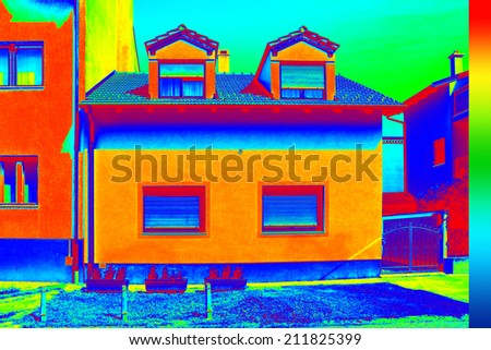 Infrared thermovision image showing lack of thermal insulation on House - stock photo