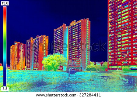 Infrared thermovision image showing lack of thermal insulation on Residential building - stock photo