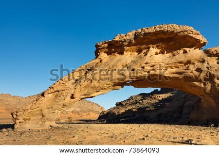 Infudha Rock Arch - Natural Rock Arch - Akakus (Acacus) Mountains, Sahara, Libya - stock photo