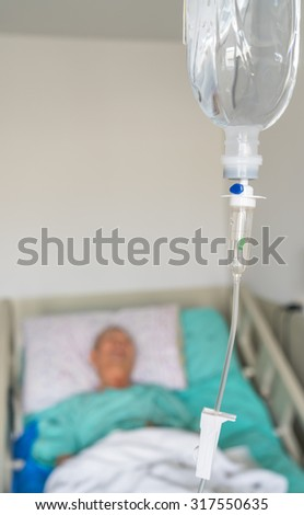 Infusion bottle with IV solution ( Filtered image processed vintage effect. ) - stock photo