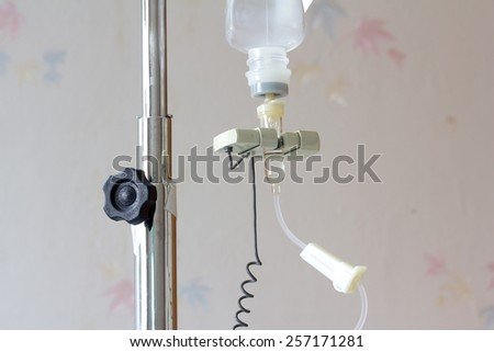 Infusion bottle with IV solution in hospital - stock photo