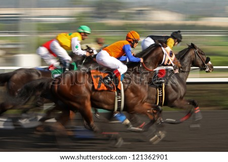"INGLEWOOD, CA - DEC 8: ""God of War"" and Juan Hernandez (black cap) hold off ""Clinton"" and Alex Bisono (orange cap) to win the 3rd race at Hollywood Park on Dec 8, 2012 in Inglewood, CA. - stock photo"
