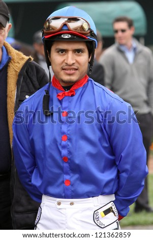 "INGLEWOOD, CA - DEC 8: Mario Gutierrez , who rode ""I'll Have Another"" to victory in 2 legs of the Triple Crown, waits for his mount in the paddock at Hollywood Park on Dec 8, 2012 in Inglewood, CA. - stock photo"