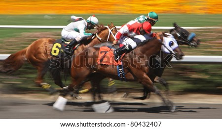 "INGLEWOOD, CA - JUL 2: ""Don Elias M"" (No. 6), with jockey Kerwin John, surges between horses to win a claiming race at Hollywood Park on July 2, 2011 in Inglewood, CA."