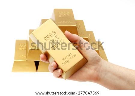 Ingot in hands - stock photo