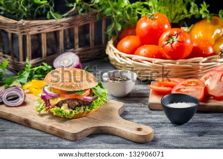 Ingredients and fresh vegetables for homemade hamburger - stock photo