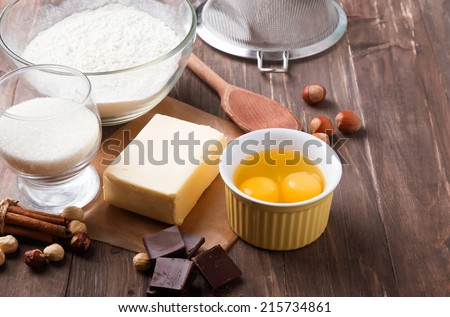 Ingredients and tools for baking sweet cake with chocolate and nuts - stock photo