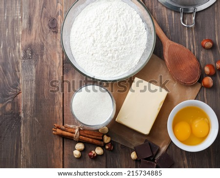 Ingredients and tools for baking sweet cake with chocolate and nuts, up view - stock photo
