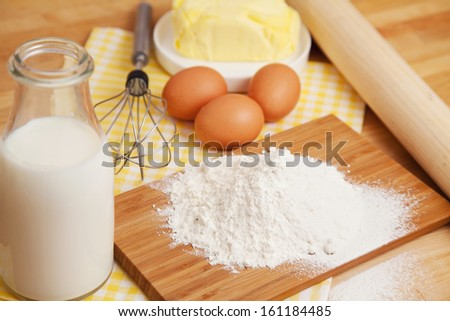 Ingredients and tools for making dough - stock photo